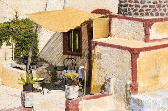 Inner courtyard of a yellow house in a typical Cycladic architectural style, Oia, Ia, Santorini, Cyclades, Greece, Europe