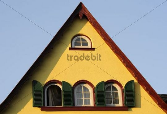 Yellow house, green shutters, red gable