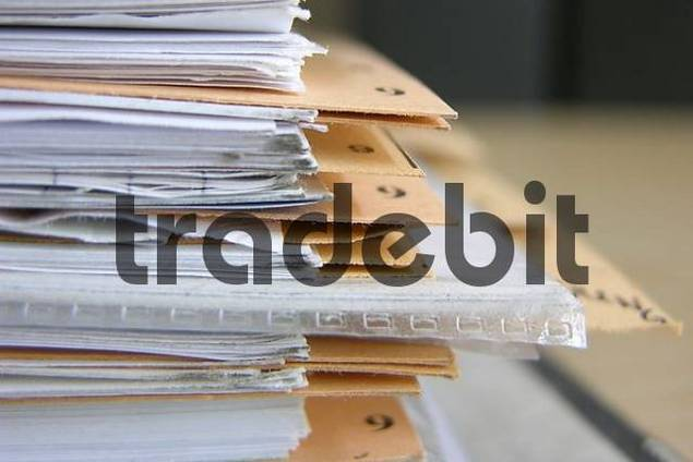 Documents in a binder with register sheets