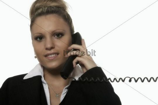 Businesswoman with a telephone in her hand