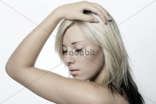 Young blonde woman with her eyes closed, portrait