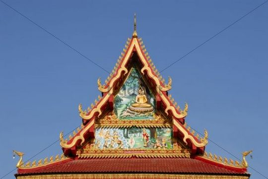 Gable with colourful paintings, modern Buddhist Temple Wat Nakoun Noi, Vientiane Province, Laos, South East Asia