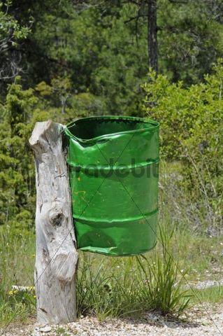 Rubbish bin, tin drum, green, battered, tree-stump, trees, Spain, Europe