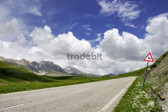 Traffic sign beside a street in the mountains under a blue sky, Gran Sasso in the Abruzzo region of Italy, Europe