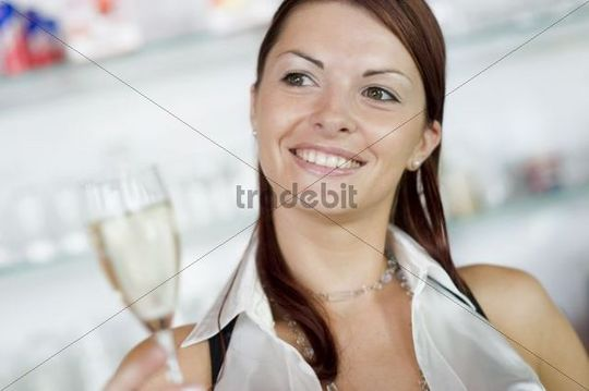 Young, attractive woman with a glass of champagne