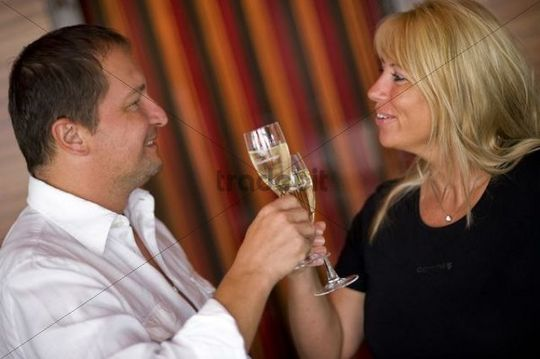 Man and woman toasting with glasses of champagne