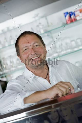 Landlord behind the bar