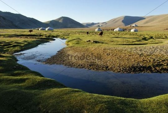 Nomadic yurts next to a river in the steppe, Aimak Bayan Ulgi, Altai, Mongolia, Asia