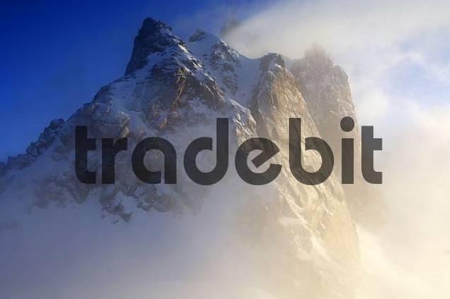 Morning mist at Aiguille du Midi 3842 m Chamonix Haute-Savoie France
