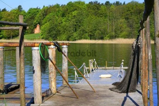 Landing stage of a fisherman with nets and landing nets on Lake Grienericksee in the municipality of Ostprignitz-Ruppin, Brandenburg, Germany, Europe