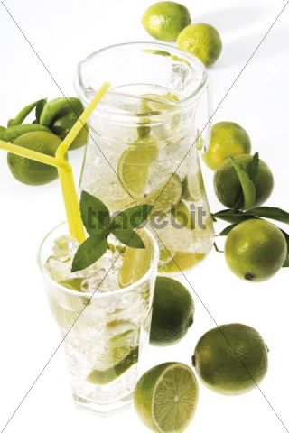 Caipirinha cocktail served with limes