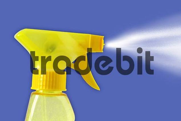 Yellow spray bottle on blue background