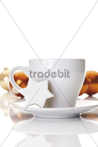 Coffee cup and cinnamon star cookie, Christmas balls at back