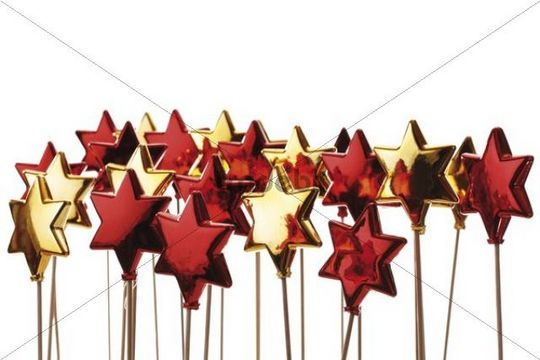 Red and golden stars on sticks