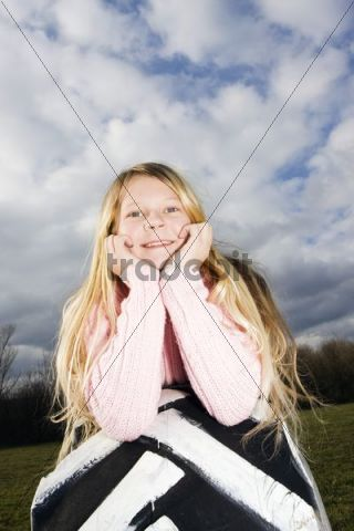 Girl, 11 years, on a tyre