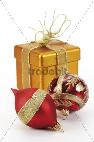 Golden giftbox and Christmas tree baubles