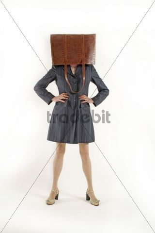 Woman with her handbag over her head