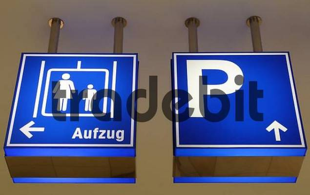 signs for parking and elevators in a departement store