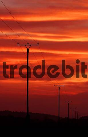 power pole with power lines in the sunset