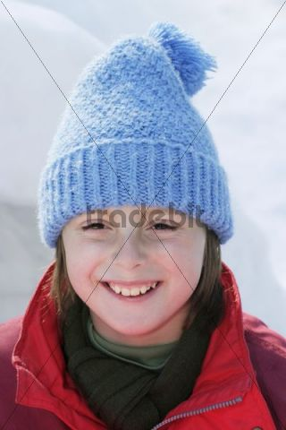 Smiling girl, 10 years, with hat, winter portrait