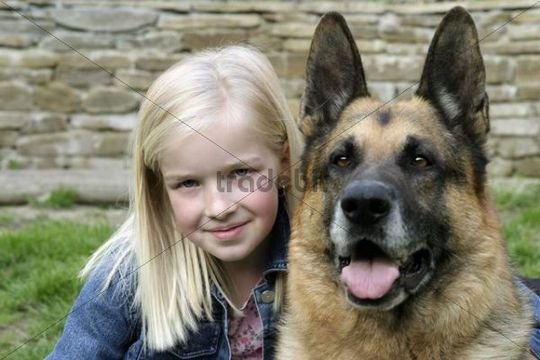 Blonde girl with German shepherd