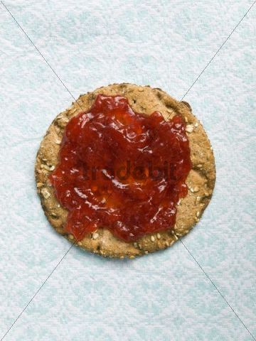 Round crisp bread with jam