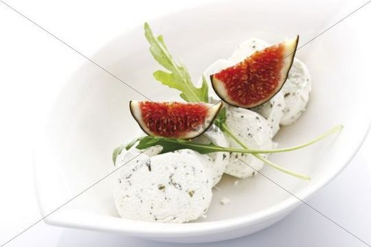 Fresh Figs Ficus carica with rucola and goat cheese