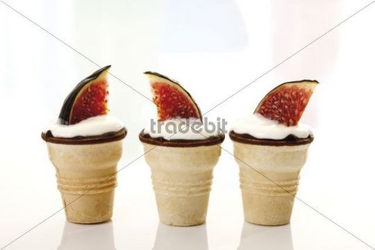 Figs Ficus carica with curd cheese served in wafer tubs