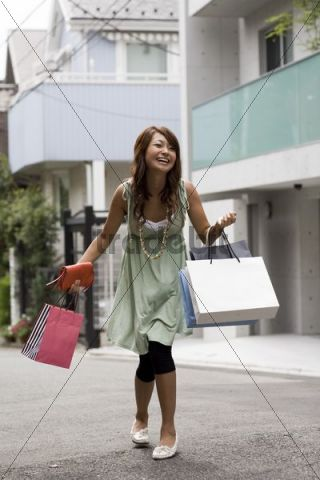 Young Asian woman shopping, Tokyo, Japan, Asia