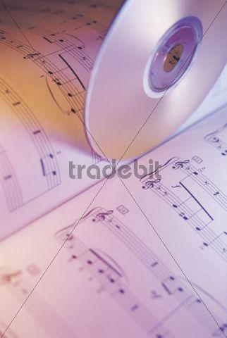 CD and music score, sheet music