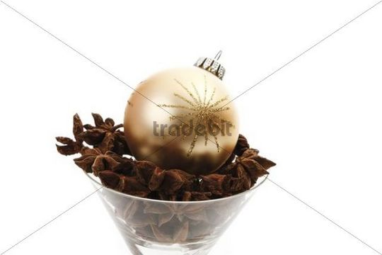 Christmas tree ball in a glass with star anise