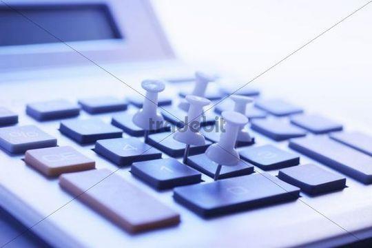 Pinboard tacks on a calculator