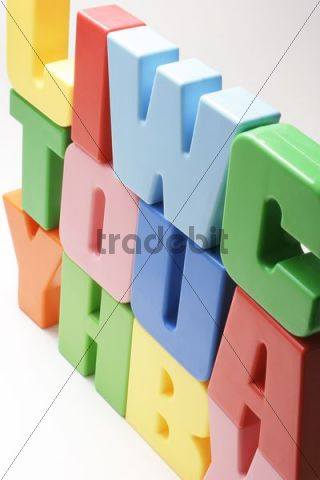 Stacked colored plastic letters of the alphabet