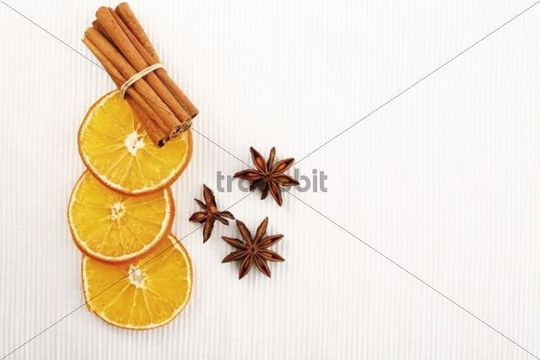 Dried slices of orange with cinnamon sticks and anise stars