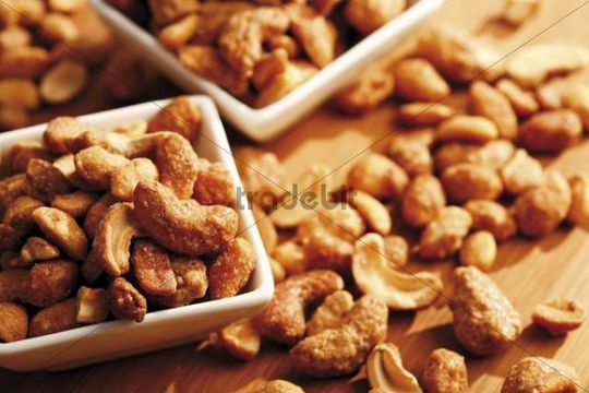 Cashew nuts with salt and honey on a table