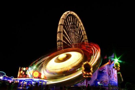 Time exposure of a carousel in front of a ferris wheel, Neu-Ulm fair, Bavaria, Germany, Europe
