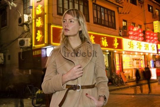 Young woman in the nightlife quarter of Shanghai, China, Asia