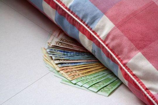 Euro notes under a pillow, financial crisis anxiety