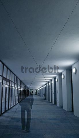 Shadow or ghost image of a man walking in an abandoned building entrance in Berlin, Germany, Europe