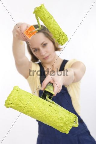 Young woman with a paint roller, do-it-yourself