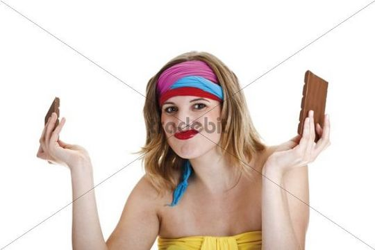 Young woman with colourful headbands and a chocolate bar in pieces
