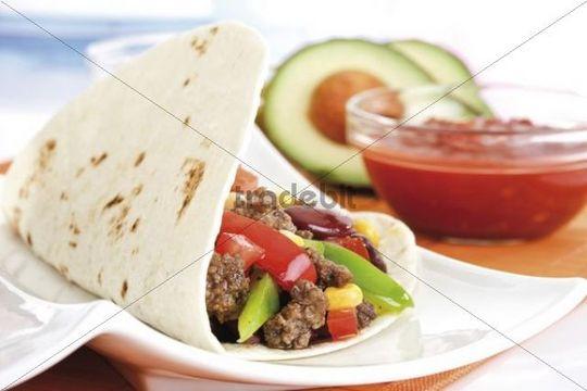 Tortillas with chili con carne and tomato salsa