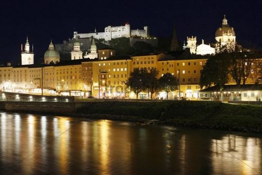 View over Salzach of the historic district of Salzburg with town hall, cathedral, Kollegienkirche Church and Festung Hohensalzburg Fortress, night shot, Salzburg, Austria, Europe