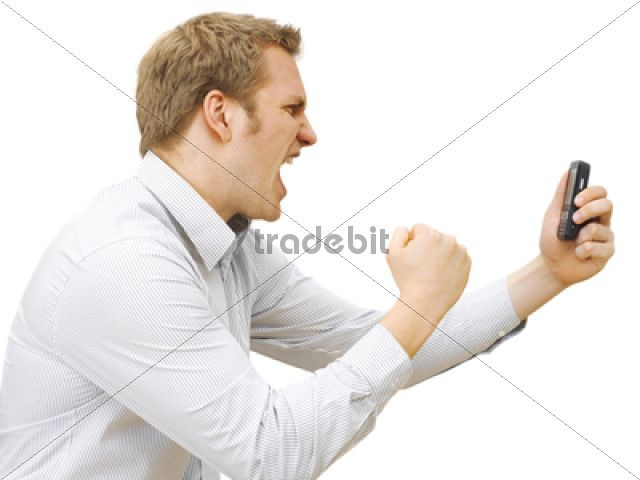 Businessman using a mobile phone, stressed, angry /