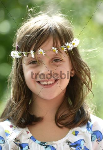 Smiling girl wearing a floral garland, portrait
