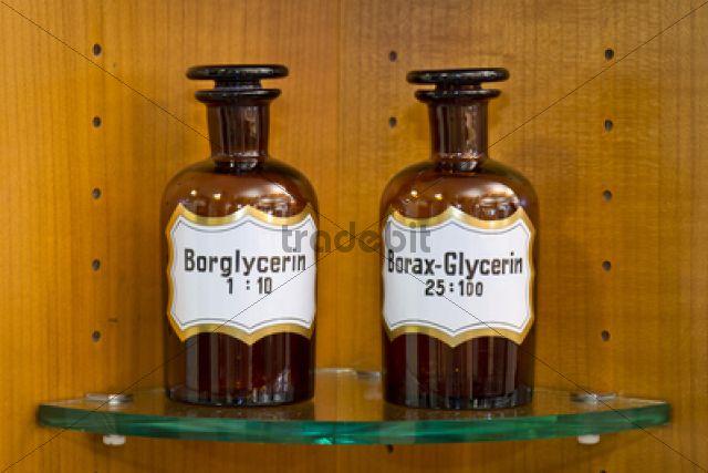 Old glass bottles for medical ingredients labeled glycerin in a pharmacy, Stuttgart, Baden-Wuerttemberg, Germany, Europe